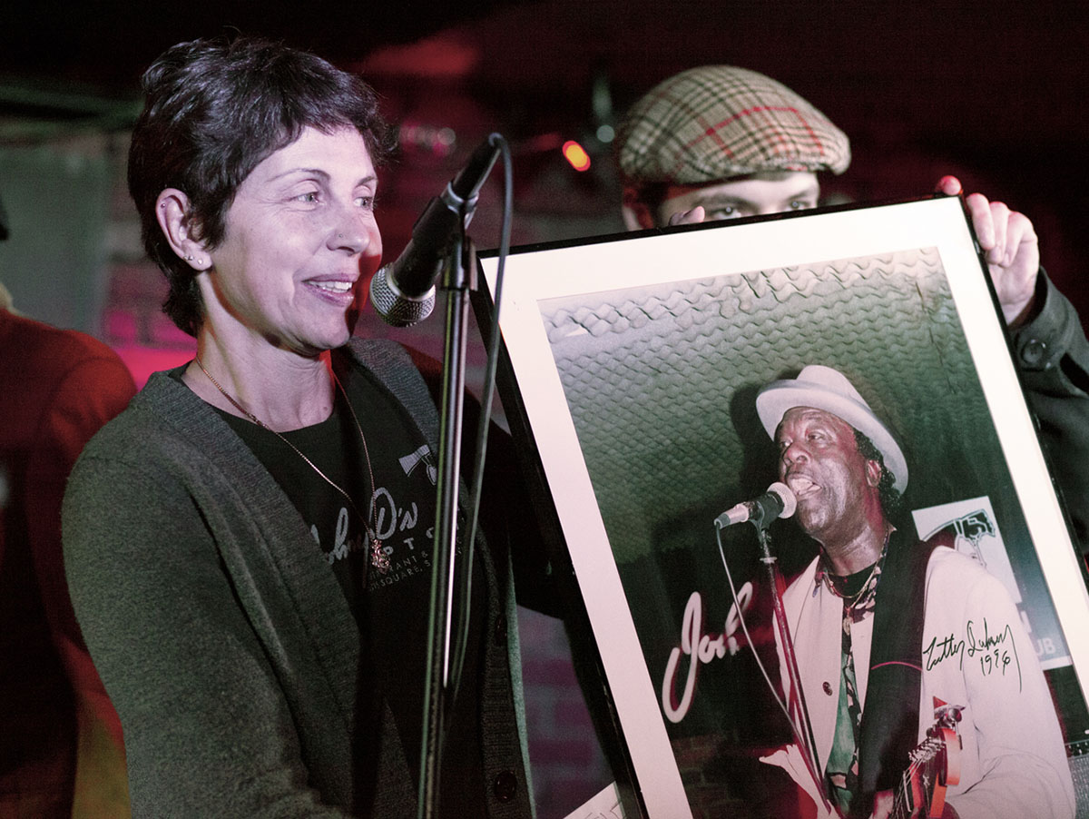 "Johnny D's owner Carla DeLellis presenting Luther ""Guitar Junior"" Johnson"