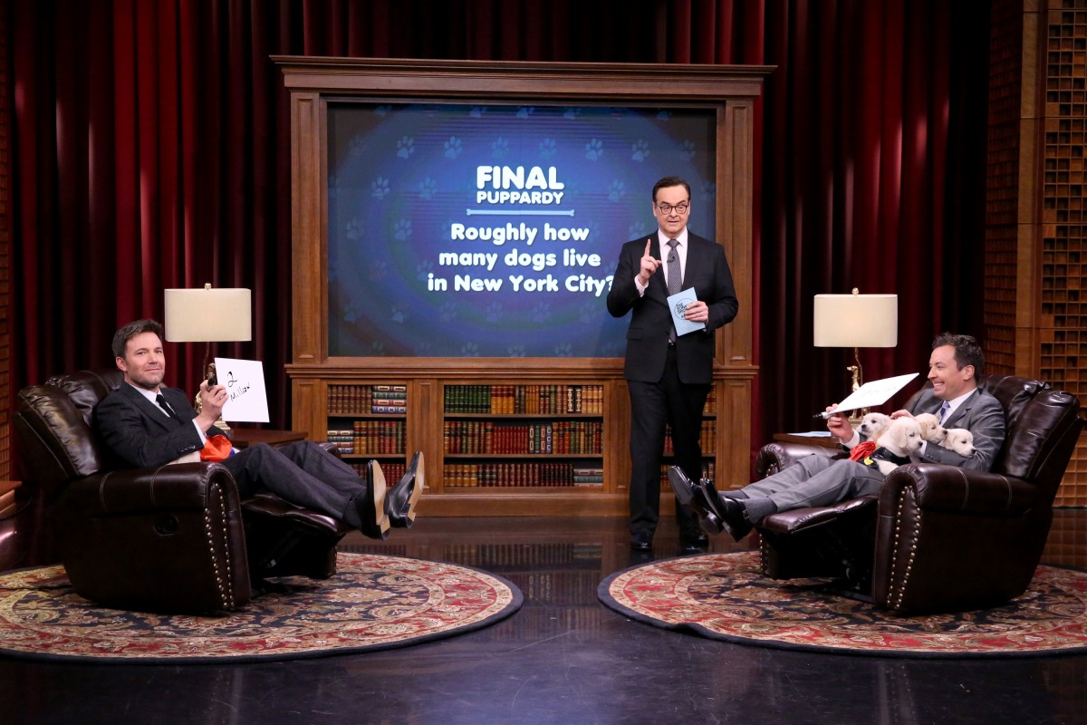 """THE TONIGHT SHOW STARRING JIMMY FALLON -- Episode 0440 -- Pictured: (l-r) Actor Ben Affleck, announcer Steve Higgins, and host Jimmy Fallon play """"Pup Quiz"""" on March 24, 2016 -- (Photo by: Andrew Lipovsky/NBC)"""