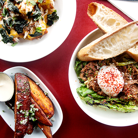 March 23, 2016 - Popular lunch items at Strip-T's in Watertown, Mass. include the grilled romaine and oxtail salad and french fries. The rice tots (above left) are a popular starter on the dinner menu. Photo by Alexandra Wimley