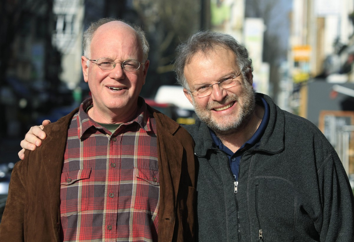 Ben Cohen, left, and Jerry Greenfield, right, cofounders of the Ben & Jerry ice-cream company, pose for the Associated Press in central London, Wednesday Feb. 17, 2010. Ben & Jerry's is stepping up its commitment to ethical business, announcing Thursday Feb. 18, 2010 that all its 58 flavors of icecream _ sold in 39 countries around the world _ will be sourced from fair trade certified products by the end of 2013.Greenfield and Cohen no longer have any board or management position at Ben & Jerry's, which has annual global sales of 500 million US dollars, after selling the company to Anglo-Dutch food major Unilever NV in 2000. But they are still engaged with the company they started with a single ice cream parlour in a renovated gas station in downtown Burlington, Vermont, in 1979 and continue to act as watchdogs for the company's progress on social values. (AP Photo/Lefteris Pitarakis)
