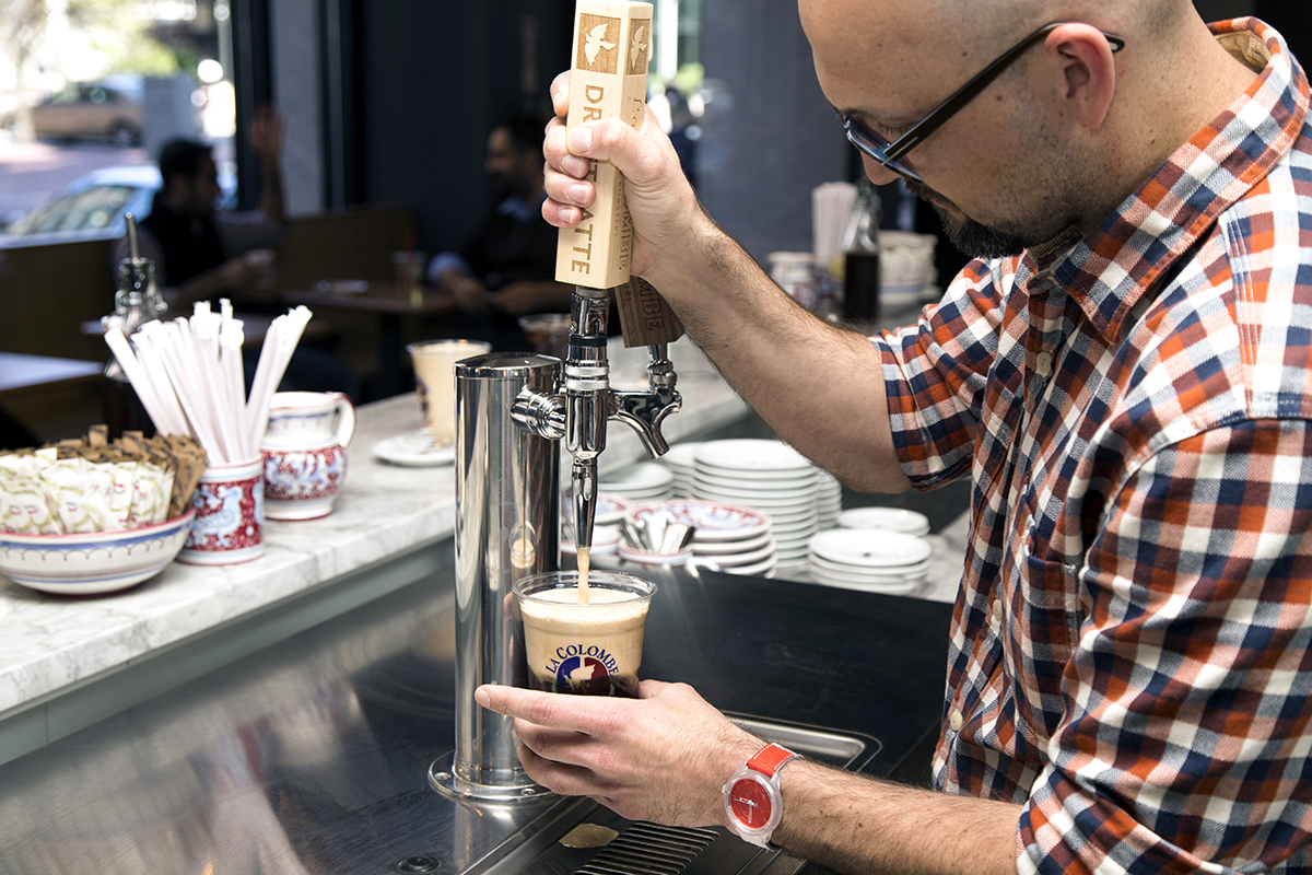 La Colombe South Station cafe manager Derek Craig pours a 'Pure Black and tan.'