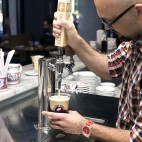 La Colombe South Station cafe manager Derek Creaig pours a 'Pure Black and tan.'