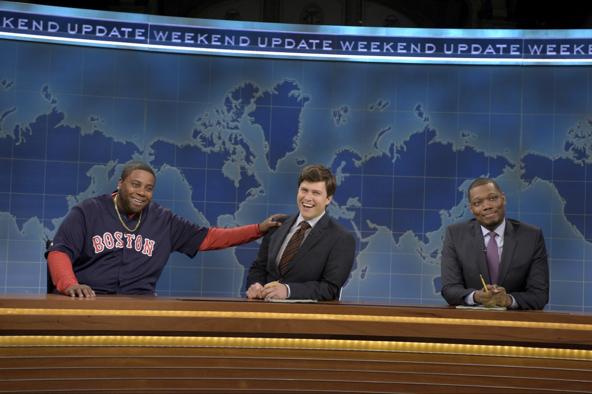 """SATURDAY NIGHT LIVE -- """"Peter Dinklage"""" Episode 1699 -- Pictured: (l-r) Kenan Thompson as David Ortiz, Colin Jost, and Michael Che during Weekend Update on April 2, 2016 -- (Photo by: Dana Edelson/NBC)"""