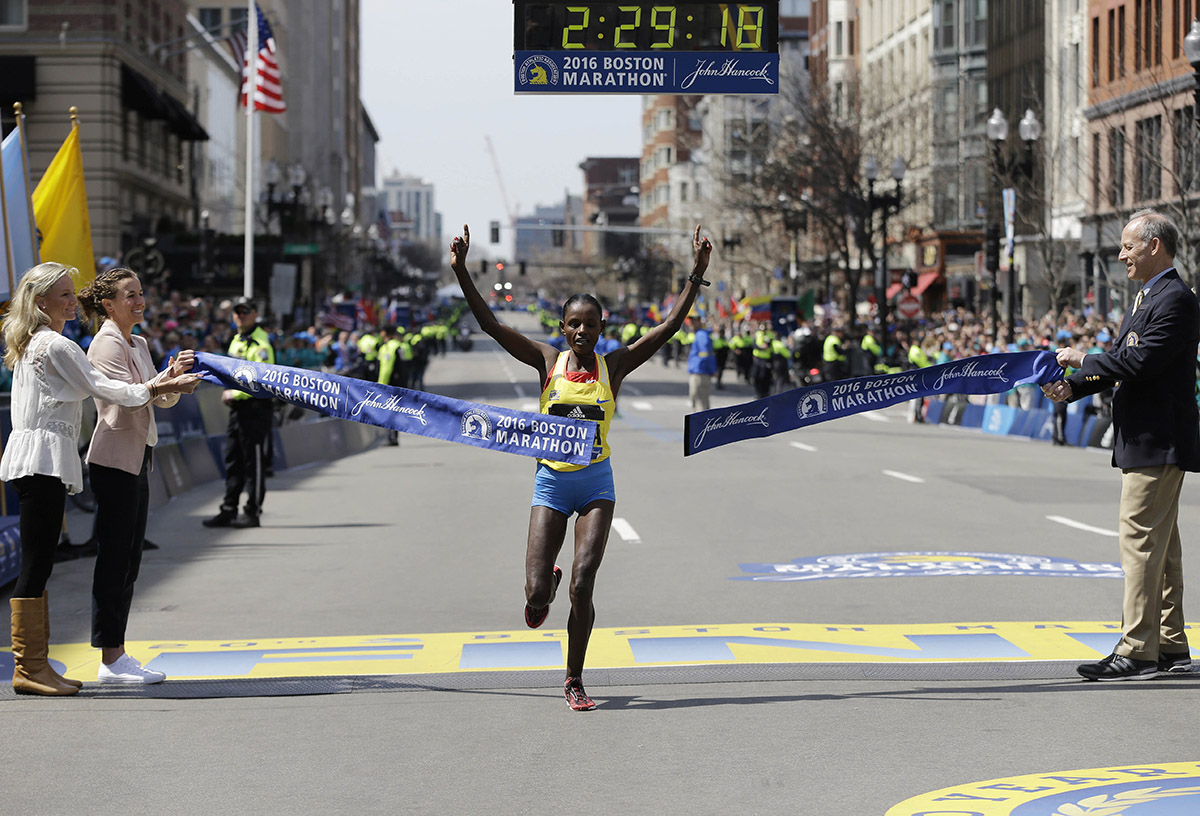 Atsede Baysa breaks the tape to win the women's division. / Photo via AP