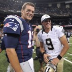 New England Patriots quarterback Tom Brady (12) and New Orleans Saints quarterback Drew Brees (9) greet each other after an NFL preseason football game in New Orleans, Saturday, Aug. 22, 2015. (AP Photo/Bill Feig)