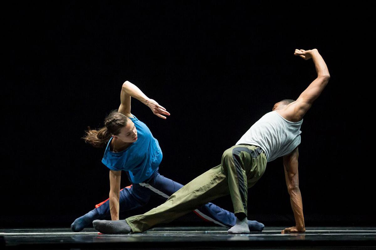 Two dancers dance.
