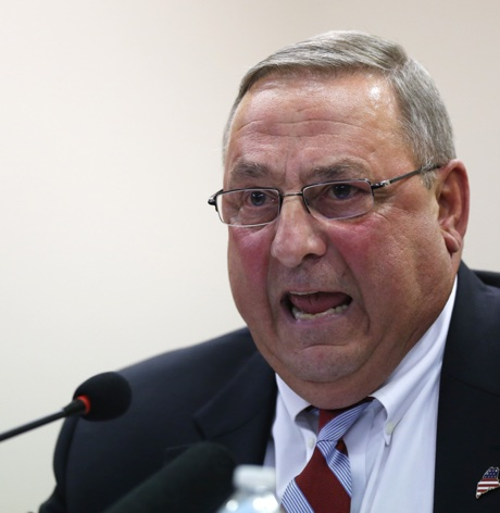 Gov. Paul LePage speaks at a town hall meeting Wednesday, Oct. 21, 2015, in Auburn, Maine. The Republican governor railed against Question 1 on November's statewide ballot, saying the proposed expansion of Maine's public campaign finance system will not reduce money's influence on politics. (AP Photo/Robert F. Bukaty)