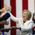Democratic presidential candidate Hillary Clinton reacts to supporters as she arrives to speak at her Super Tuesday election night rally in Miami, Tuesday, March 1, 2016. (AP Photo/Gerald Herbert)