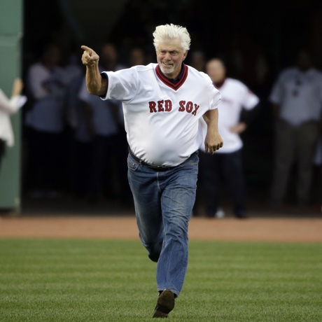 "Boston Red Sox former pitcher Bill ""Spaceman"" Lee runs onto the field to join former teammates during pre-game ceremonies at Fenway Park in Boston, Tuesday, May 5, 2015 honoring the 1975 Boston Red Sox baseball team which won the American League pennant. (AP Photo/Elise Amendola)"