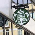 Monte-Carlo, Monaco - March 9, 2016: Starbucks Sign is Displayed at the Facade of a Starbuks store. Starbucks Corporation is an American Coffee Company and the Largest Coffeehouse Company in the world with 23,450 Stores in 67 Countries