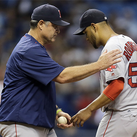 Boston Red Sox manager John Farrell, left, takes the ball from starting pitcher Eduardo Rodriguez as he takes Rodriguez out of a baseball game against the Tampa Bay Rays during the third inning Monday, June 27, 2016, in St. Petersburg, Fla. (AP Photo/Chris O'Meara)