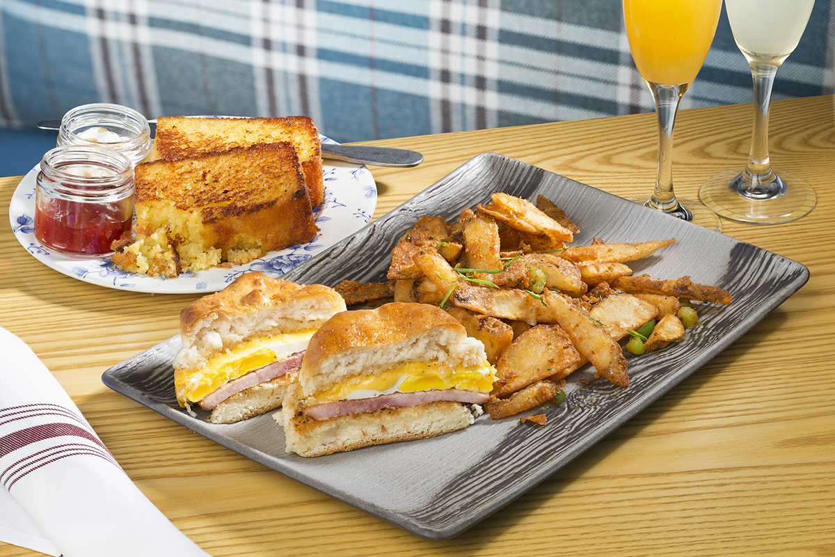 Egg biscuit sandwich (forground) and skillet cornbread (background. / Photo by Joe Greene
