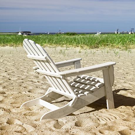 Beach chair in Chatham bay harbor in Barnstable Massachusetts USA