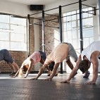 Shot of a group of people stretching in a fitness class
