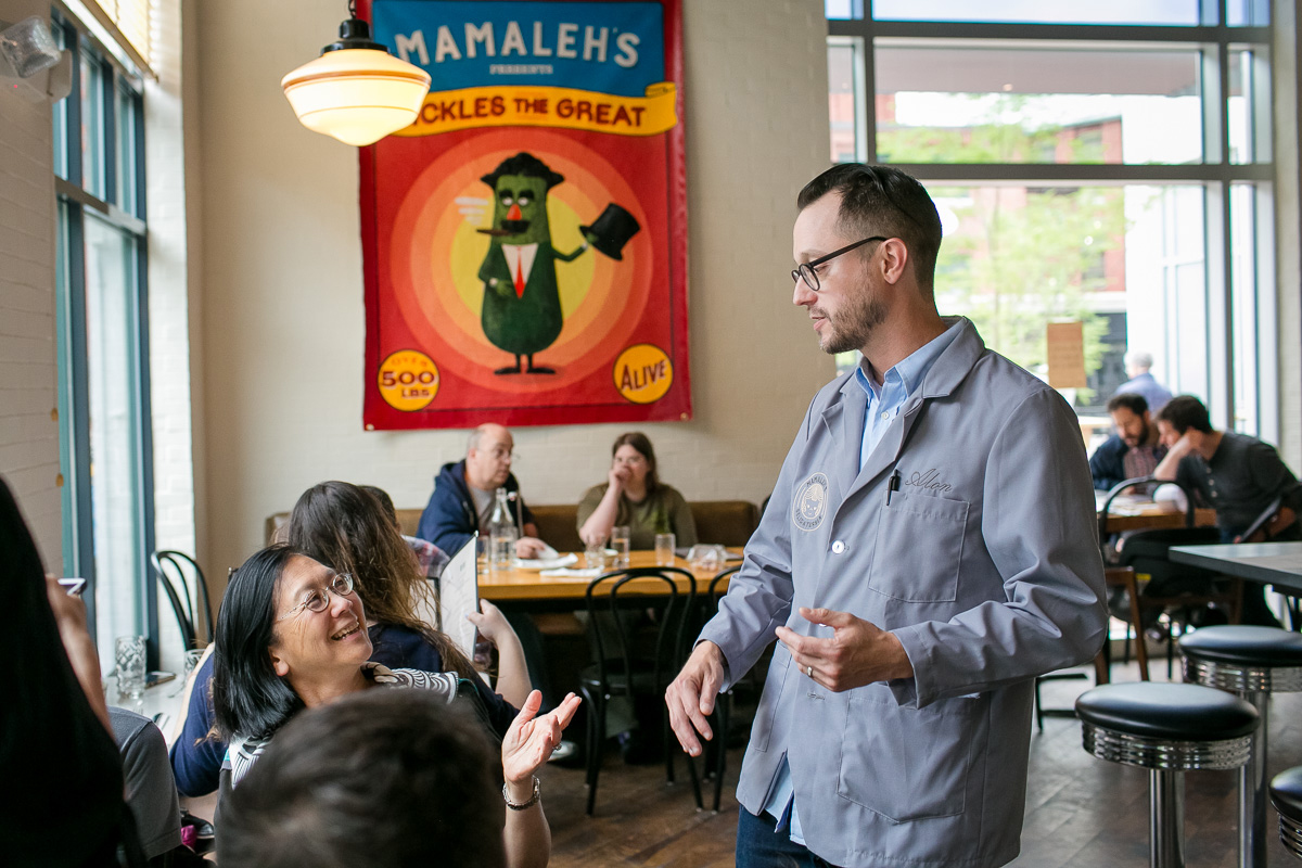Owner Alon Munzer greets guests at Mamaleh's. / Photo by Nir Landau