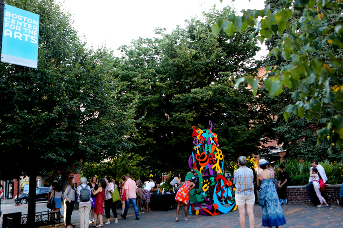 crowds admire completed emergence sculpture