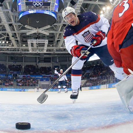 USA forward David Backes reacts as forward Zach Parise goal shot gets by Czech Republic goaltender Ondrej Pavelec during the second period of men's quarterfinal hockey game in Shayba Arena at the 2014 Winter Olympics, Wednesday, Feb. 19, 2014, in Sochi, Russia. (AP Photo/Brian Snyder, Pool)