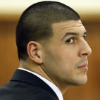 Former New England Patriots football player Aaron Hernandez listens during his murder trial, Thursday, Jan. 29, 2015, in Fall River, Mass. Hernandez is charged with killing semiprofessional football player Odin Lloyd, 27, in June 2013.  (AP Photo/Steven Senne, Pool)