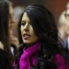 Linda Pizzuti and her husband Liverpool owner John Henry, right, arrives ahead of the English Premier League soccer match between Liverpool and Tottenham Hotspur at Anfield Stadium, Liverpool, England, Tuesday Feb. 10, 2015. (AP Photo/Jon Super)