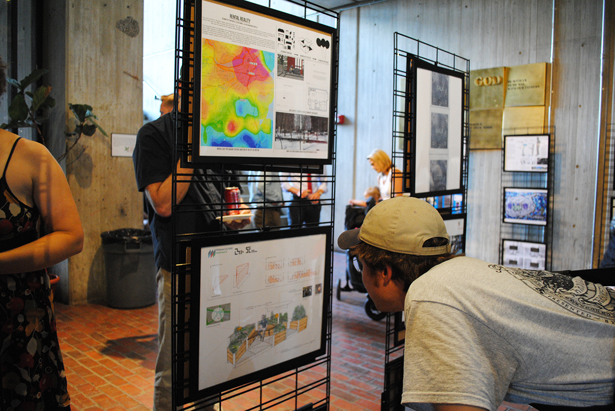 A visitor inspects a project proposal poster. / Photo by Madeline Bilis