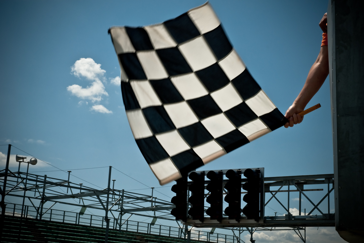 Waving the checkered flag.
