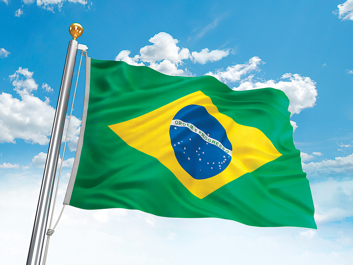 Waving Brazil flag against cloudy sky. High resolution 3D render.