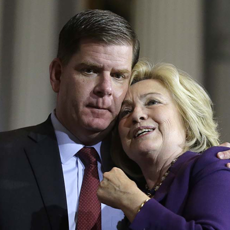"""Democratic presidential candidate Hillary Clinton, right, and Boston Mayor Marty Walsh, left, embrace on stage at the conclusion of a rally at Faneuil Hall, Sunday, Nov. 29, 2015, in Boston. The event was held to launch """"Hard Hats for Hillary,"""" a coalition created to organize people in industries and labor to support Clinton's agenda. (AP Photo/Steven Senne)"""