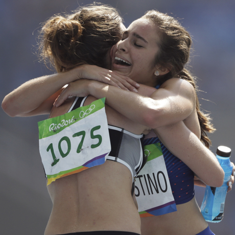 New Zealand's Nikki Hamblin, left, and United States' Abbey D'Agostino after competing in a women's 5000-meter heat during the athletics competitions of the 2016 Summer Olympics at the Olympic stadium in Rio de Janeiro, Brazil, Tuesday, Aug. 16, 2016. (AP Photo/David J. Phillip)