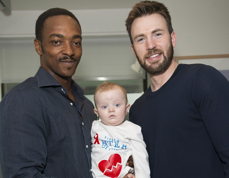 Anthony Mackie and Chris Evans with a patient at MGH