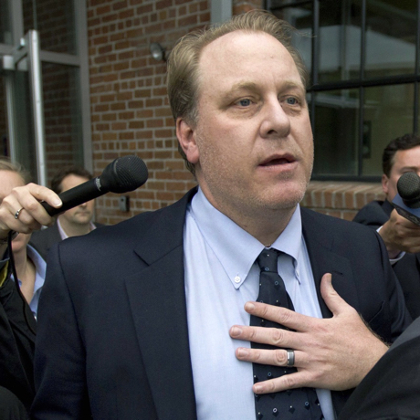 FILE - In this Wednesday, May 16, 2012, file photo, former Boston Red Sox pitcher Curt Schilling, center, is followed by members of the media as he departs the Rhode Island Economic Development Corporation headquarters, in Providence, R.I. The U.S. Securities and Exchange Commission on Monday, March 7, 2016, charged Rhode Island's economic development agency and Wells Fargo with defrauding investors in the state's disastrous $75 million deal with 38 Studios, the failed video game company started by the former Red Sox pitcher. (AP Photo/Steven Senne, File)