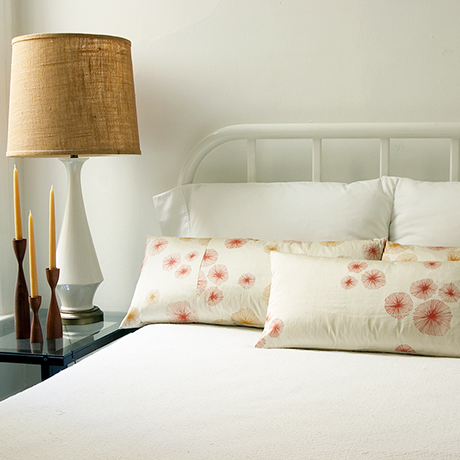 White bed with silk screened pillows