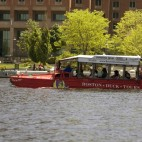 Boston, MA, USA - May 29, 2008: A Duck Tours amphibious bus motors along the Charles River on May 29, 2008 in Boston, MA, USA.  The tour is a popular way to see Boston from both land and river,  The inovative tour busses are converted surplus WWII era DUKW amphibious transports.