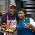 Chef Marcus Sameulsson and Mindy Kaling pose for a photo with Fried Bird Royale in the kitchen at Red Rooster, as seen on Cooking Channel's Star Plates, Season 1.