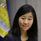 In this Jan. 13, 2016 photo, Boston City Council President Michelle Wu presides over a meeting at City Hall in Boston. Wu has made history with her election as the council's first Asian-American president. (AP Photo/Elise Amendola)