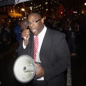 Boston City Councilor Tito Jackson leads Occupy Boston protestors in a chant during a march along Commercial Street to the Charlestown Bridge in Boston, Thursday evening, Nov. 17, 2011. (AP Photo/Stephan Savoia)