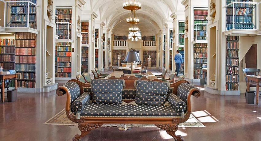 A member browses the stacks of the fifth floor reading room at the Boston Athenaeum. The Boston Athenaeum's Conservation Lab works to preserve the books in this room and others. (JR 365 Photo/Madeline Bilis)
