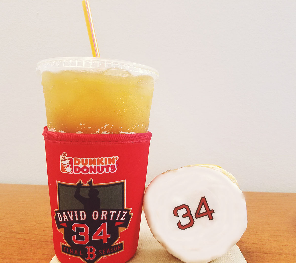 Commemorative #34 cup koozie and jelly doughnuts at Dunkin' Donuts