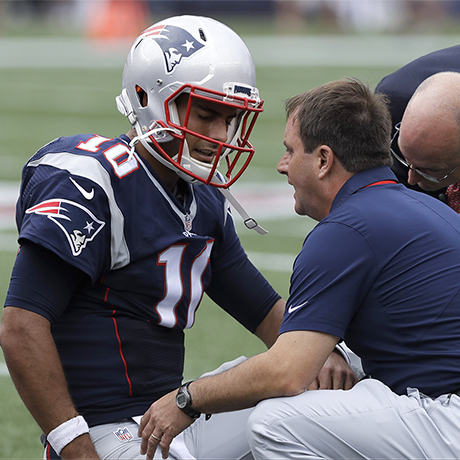 New England Patriots quarterback Jimmy Garoppolo receives attention after an injury during the first half of an NFL football game against the Miami Dolphins Sunday, Sept. 18, 2016, in Foxborough, Mass. (AP Photo/Charles Krupa)