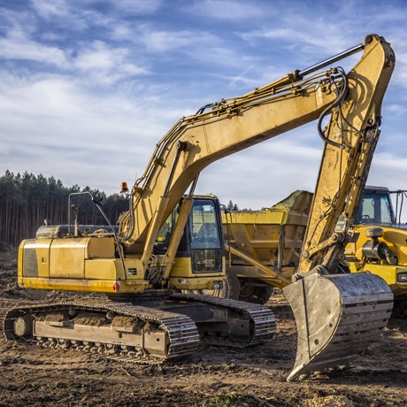 Excavator and dump truck on the construction of a new highway S3, Lubuskie province, Poland