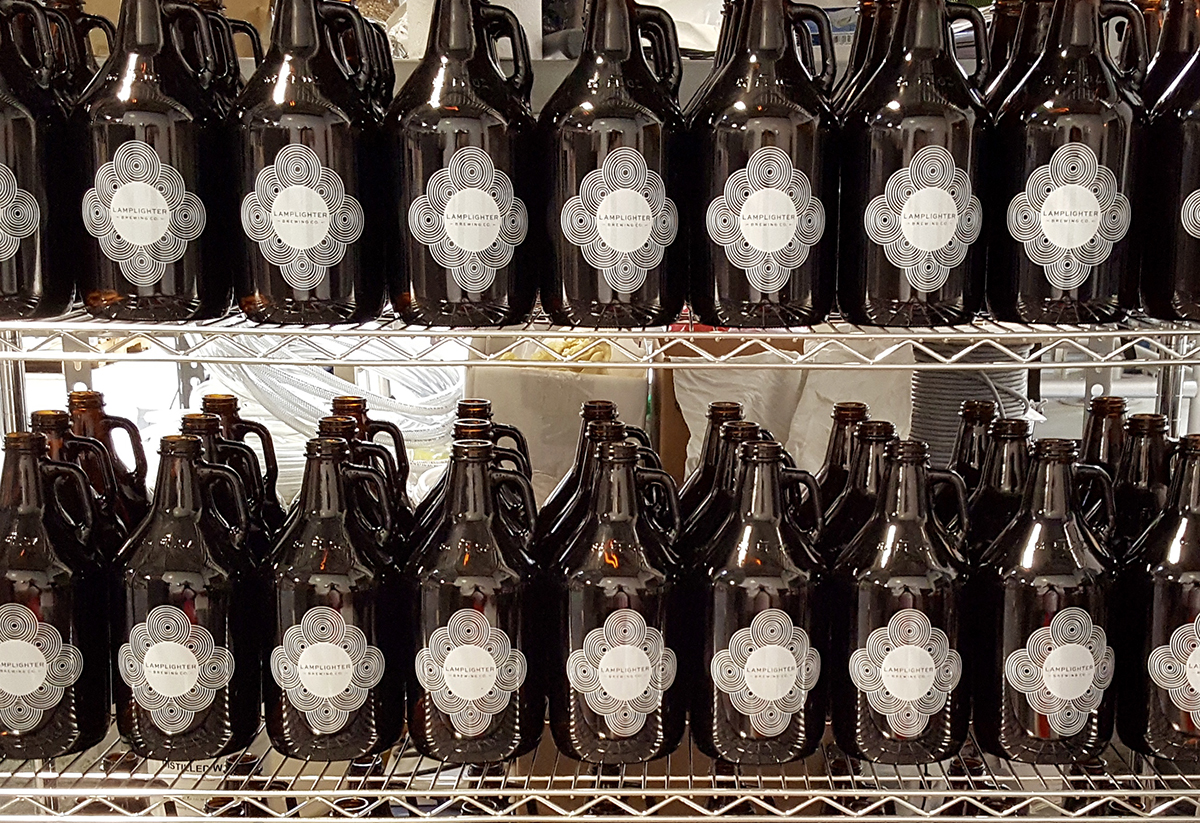 Growlers at Lamplighter Brewing Company. / Photo provided