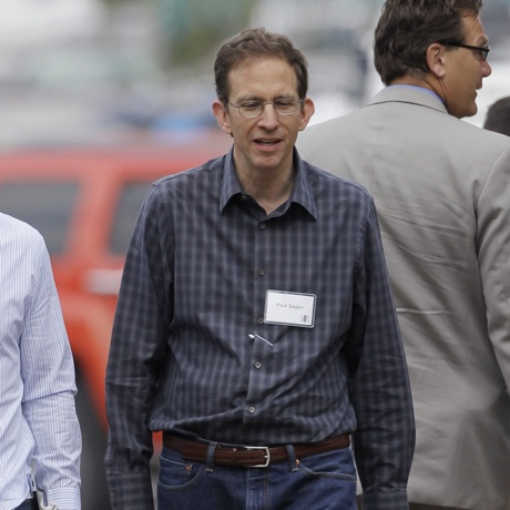 Apple CEO Tim Cook, left, and Paul Sagan, right, CEO of Akamai, arrive at the Allen & Company Sun Valley Conference in Sun Valley, Idaho, Wednesday, July 11, 2012. (AP Photo/Paul Sakuma)