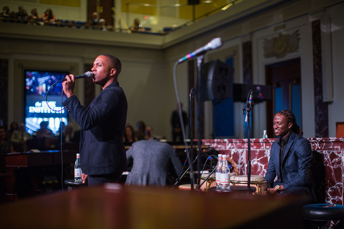 """Leslie Odom, Jr. (white sneakers) and Daveed Diggs perform """"Wait For It"""" from the Broadway musical Hamilton at the 2016 EMK Institute gala in Dorchester"""