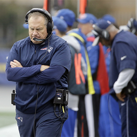 New England Patriots head coach Bill Belichick, left, walks on the sideline during the second half of an NFL football game against the Buffalo Bills Sunday, Oct. 2, 2016, in Foxborough, Mass. (AP Photo/Elise Amendola)