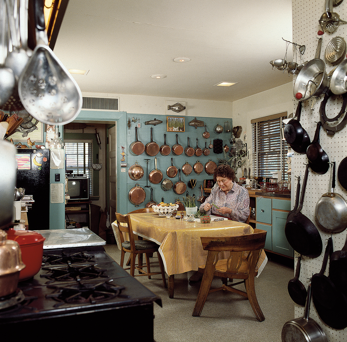Julia Child at her kitchen table in Cambridge.