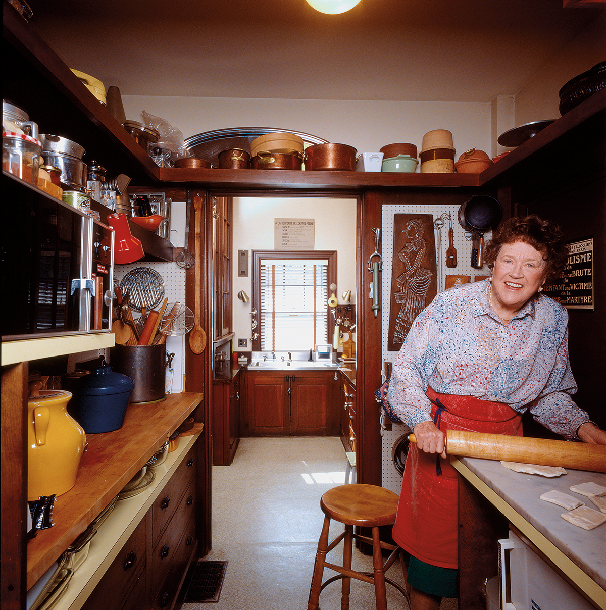 Julia Child rolling pastry in one of her Cambridge pantries.