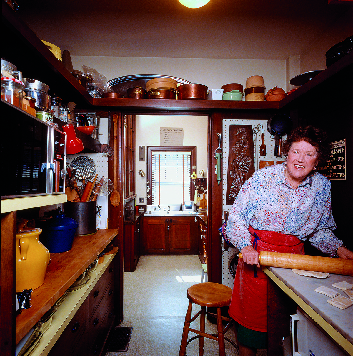 Julia Child rolling pastry in one of her Cambridge pantries. / Image from In Julia's Kitchen: Practical and Convivial Kitchen Design Inspired by Julia Child, by Pamela Heyne and Jim Scherer published by ForeEdge, an imprint of University Press of New England.