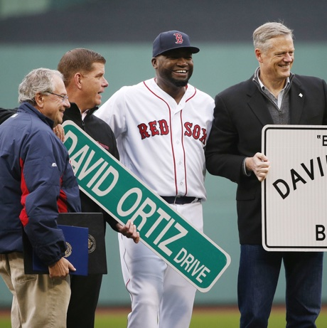 Boston Red Sox's David Ortiz, center, stands with Massachusetts Gov. Charlie Baker, right, Boston Mayor Marty Walsh, second from left, and Massachusetts Speaker of House Robert DeLeo during a ceremony to honor Ortiz before a baseball game against the Toronto Blue Jays in Boston, Sunday, Oct. 2, 2016. (AP Photo/Michael Dwyer)