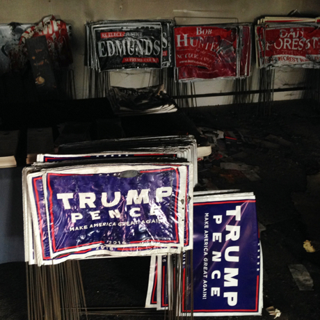 /// Melted campaign signs are seen at the Orange County Republican Headquarters in Hillsborough, NC on October 16 2016. Authorities say someone threw flammable liquid inside a bottle through a window. (Ap photo / Jonathan Drew)  DQoNCg0KU2VudCBmcm9tIG15IGlQaG9uZQ==