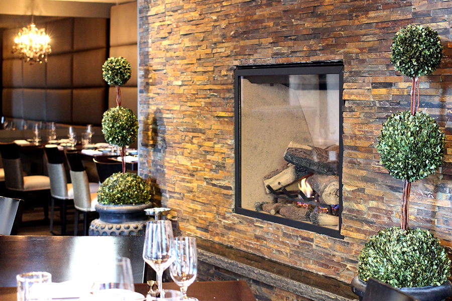 The dining room fireplace at Deuxave