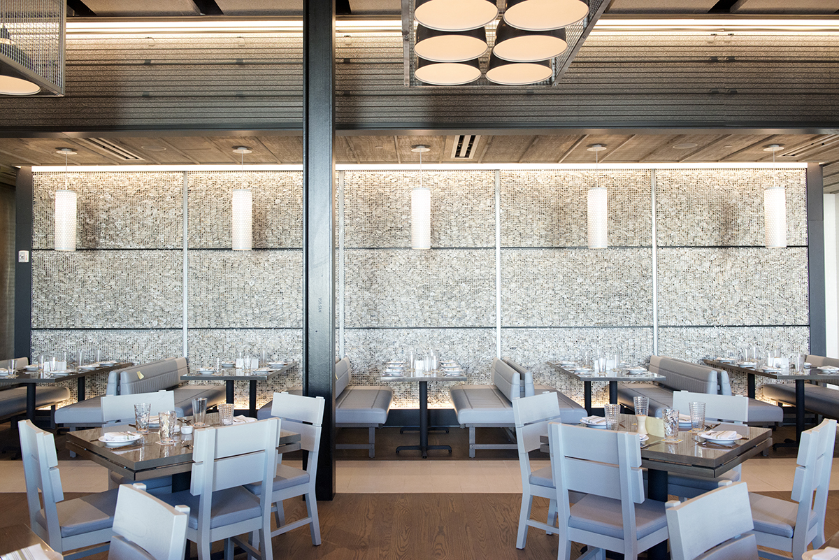 The main dining room and Gabion wall at Island Creek Oyster Bar in Burlington